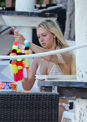 Corinne Olympios - In Bikini relaxes on the beach in Tulum - Mexico