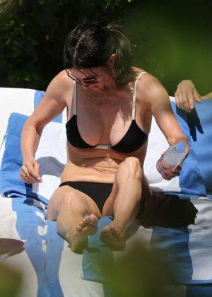 Courteney Cox in Black Bikini on the beach in Miami