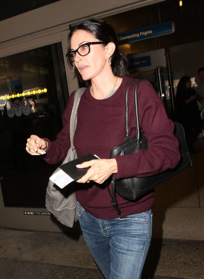 Courteney Cox in Jeans at Los Angeles International Airport