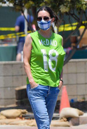 Courteney Cox - Wears a green jersey type shirt in Malibu