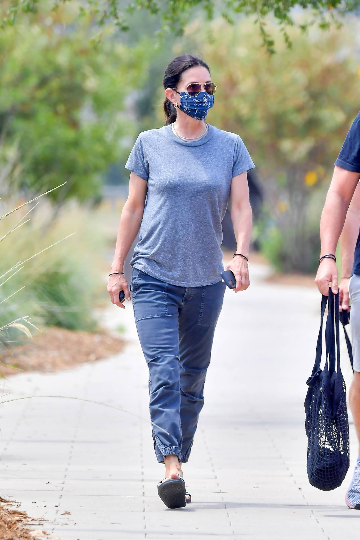 Courteney Cox - Wears a 'Vote' printed mask in Malibu