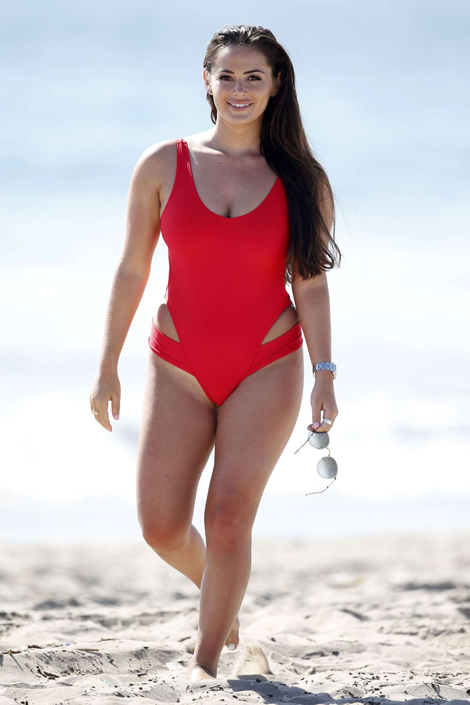 Courtney Green in Red Swimsuit on the beach in Los Angeles