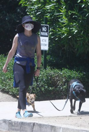 Courtney Thorne-Smith - Takes her pups out for a walk in Palisades