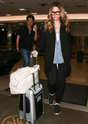 Daisy Fuentes and Richard Marx - Arriving at LAX Airport in Los Angeles