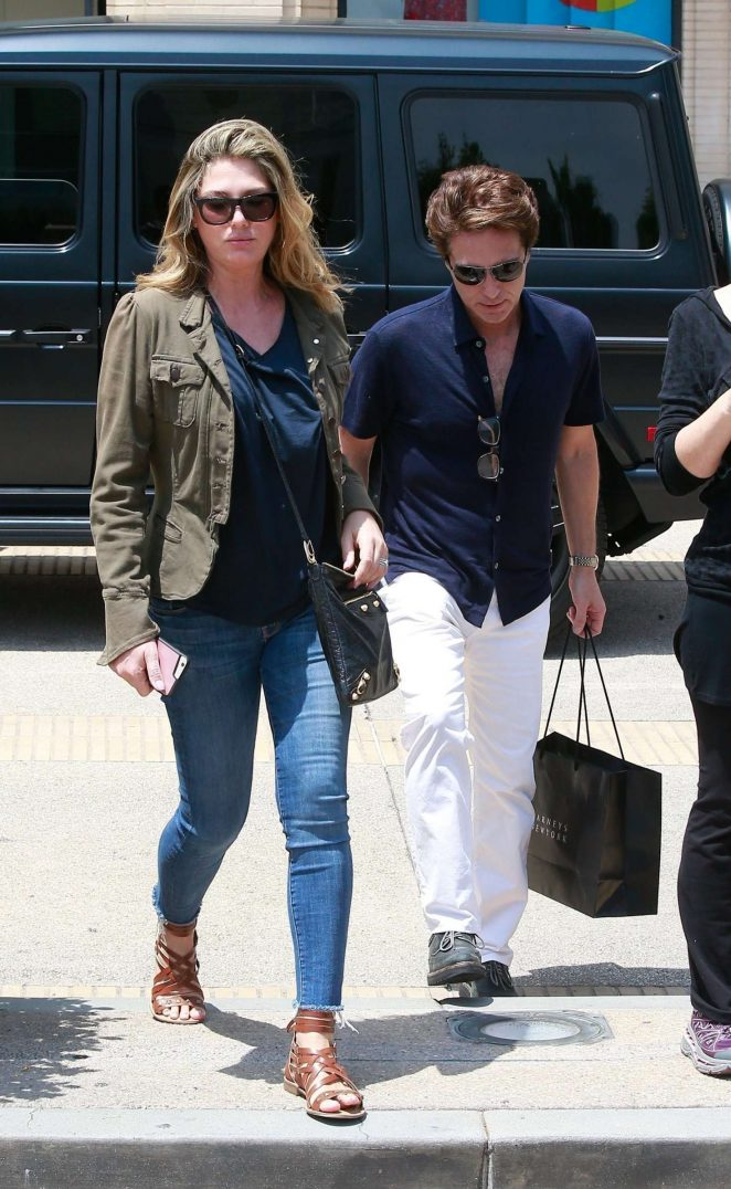 Daisy Fuentes and Richard Marx Shopping at Barneys New York in LA