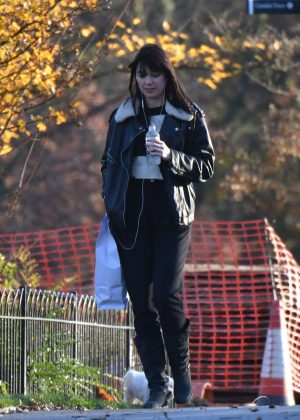 Daisy Lowe at  Regent's Park with her dog in London