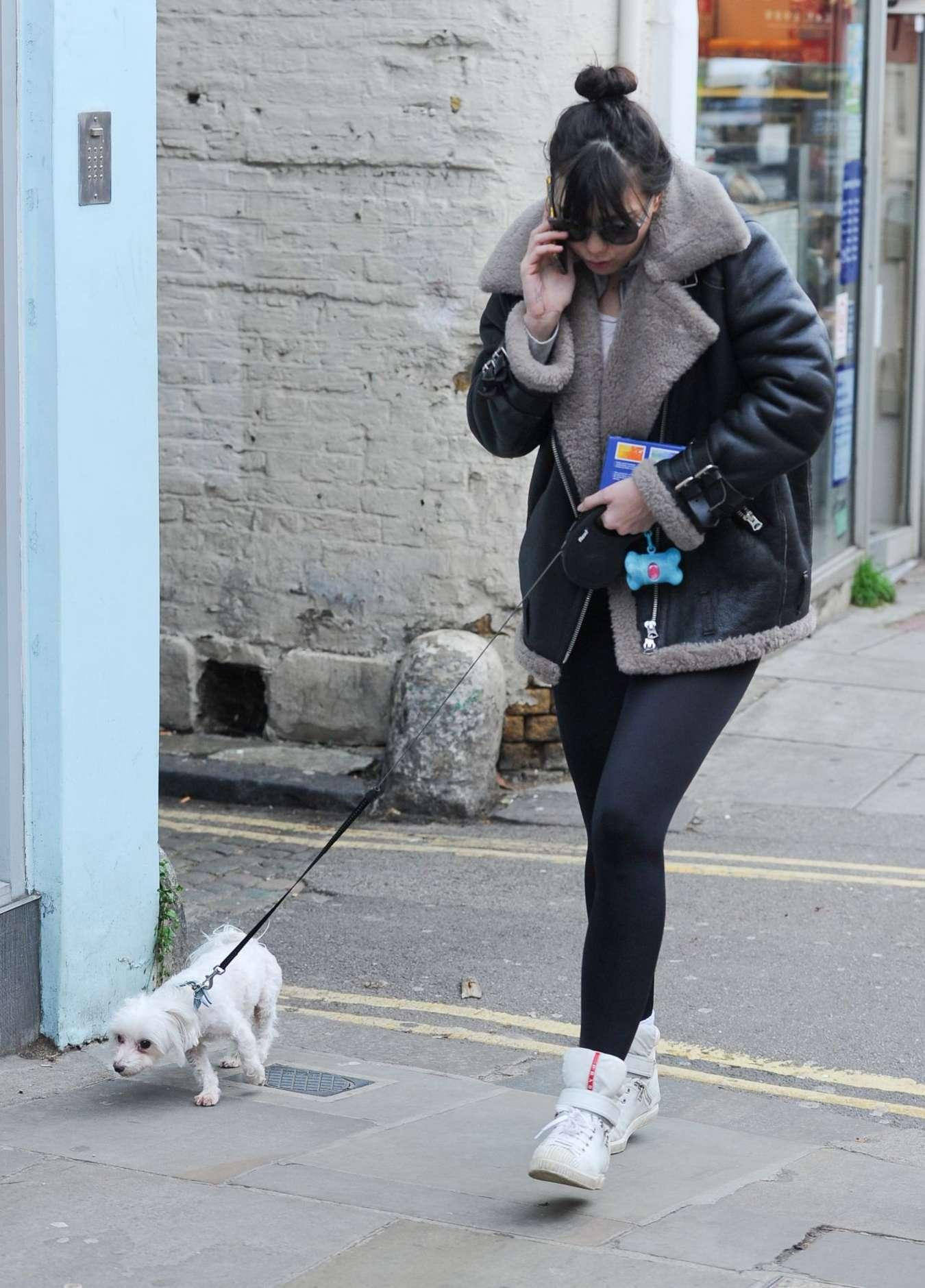 Daisy Lowe walking her dog in Hampstead