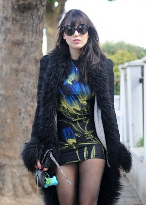 Daisy Lowe walking her pet pooch in London