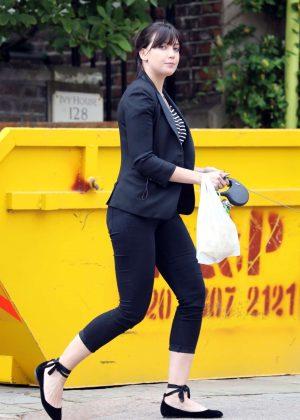 Daisy Lowe walking in Highgate village in London