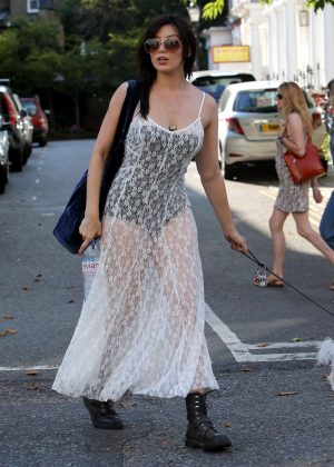 Daisy Lowe walks her dog in London