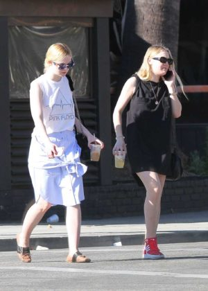 Dakota and Elle Fanning - Checking out of a hotel together in LA