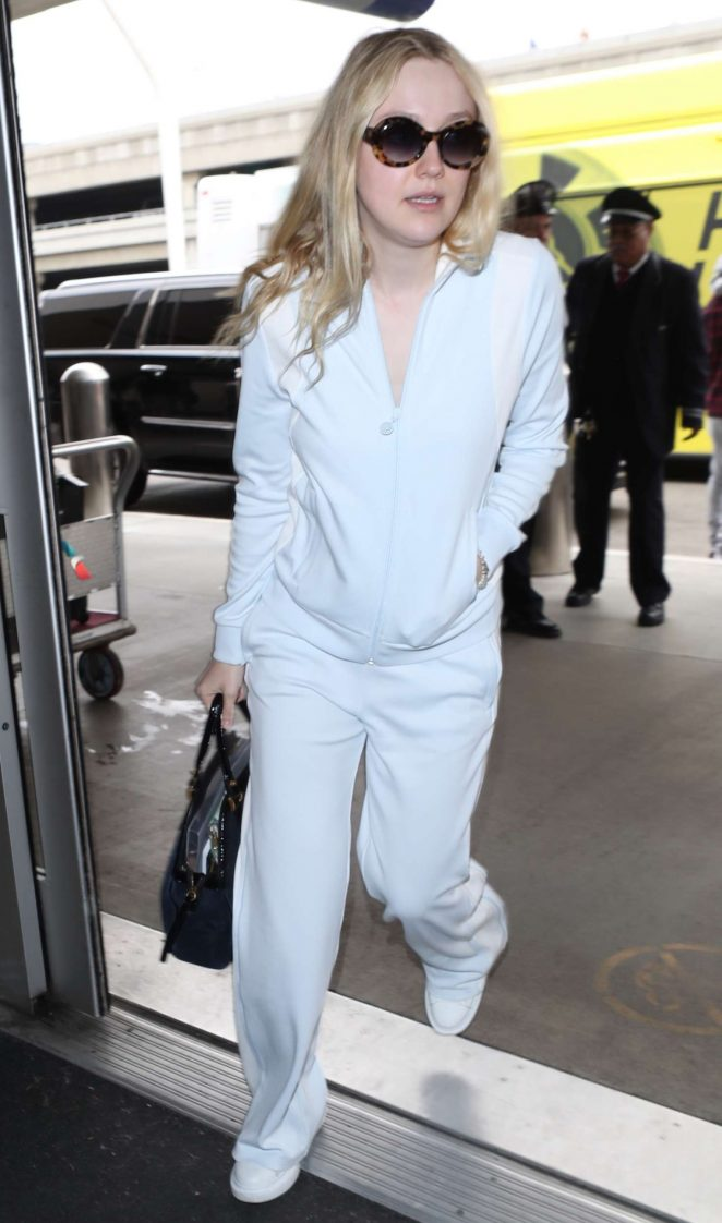 Dakota Fanning - Arriving at LAX Airport in Los Angeles