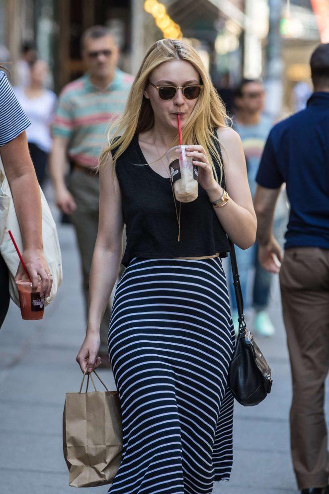 Dakota Fanning enjoys iced coffee in SoHo