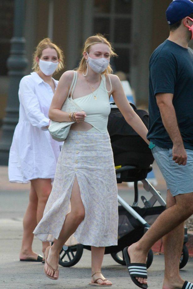 Dakota Fanning - Goes out with friends in Malibu