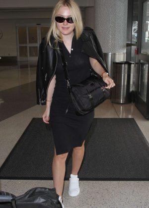 Dakota Fanning in Black Dress at LAX in Los Angeles