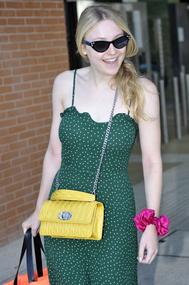 Dakota Fanning in Green Dress - Leaves from the airport in Venice