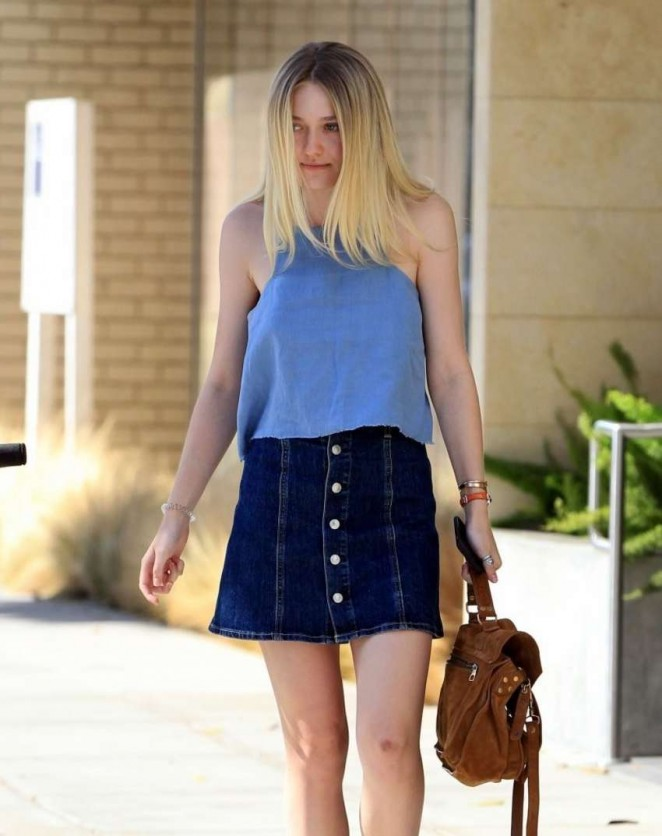 Dakota Fanning Leggy in Jeans Skirt -01