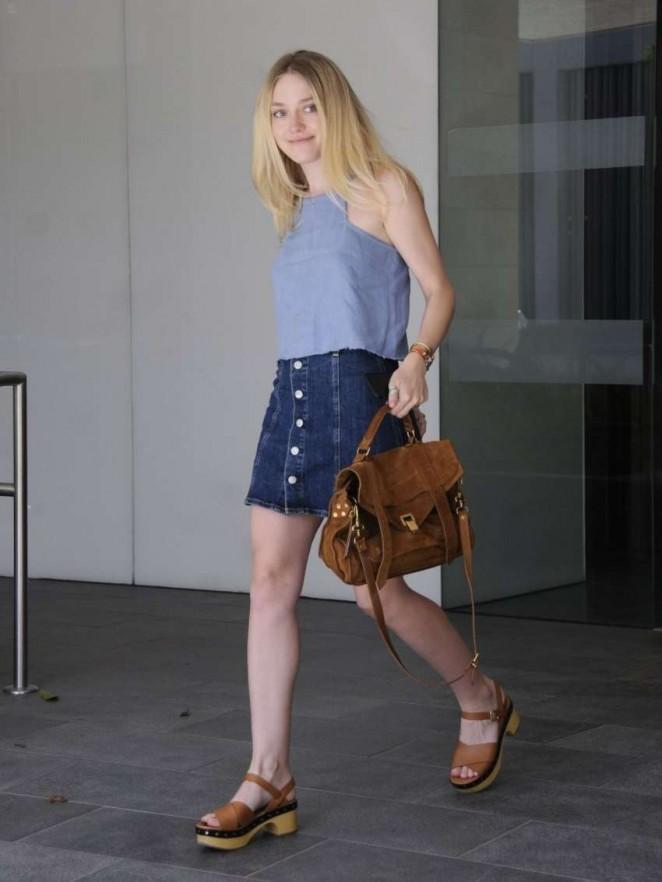 Dakota Fanning Leggy in Jeans Skirt -13