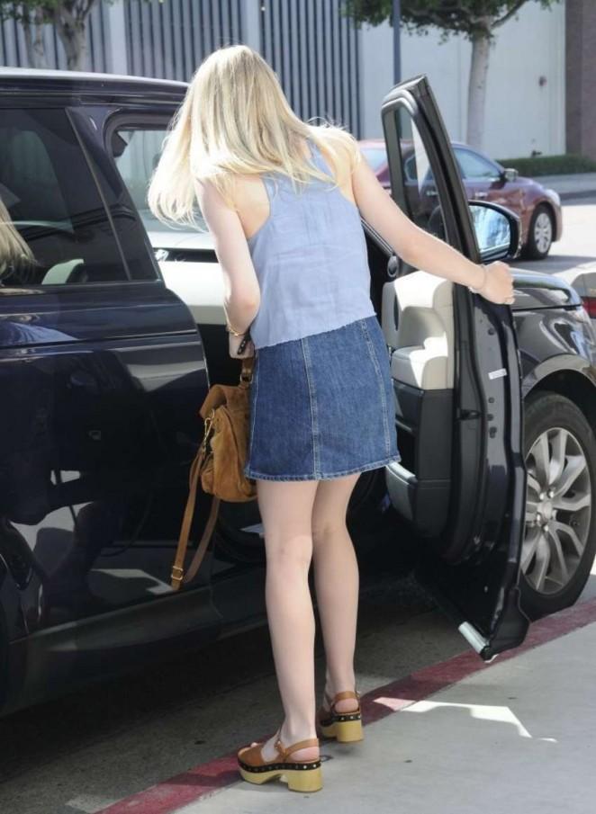 Dakota Fanning Leggy in Jeans Skirt -22