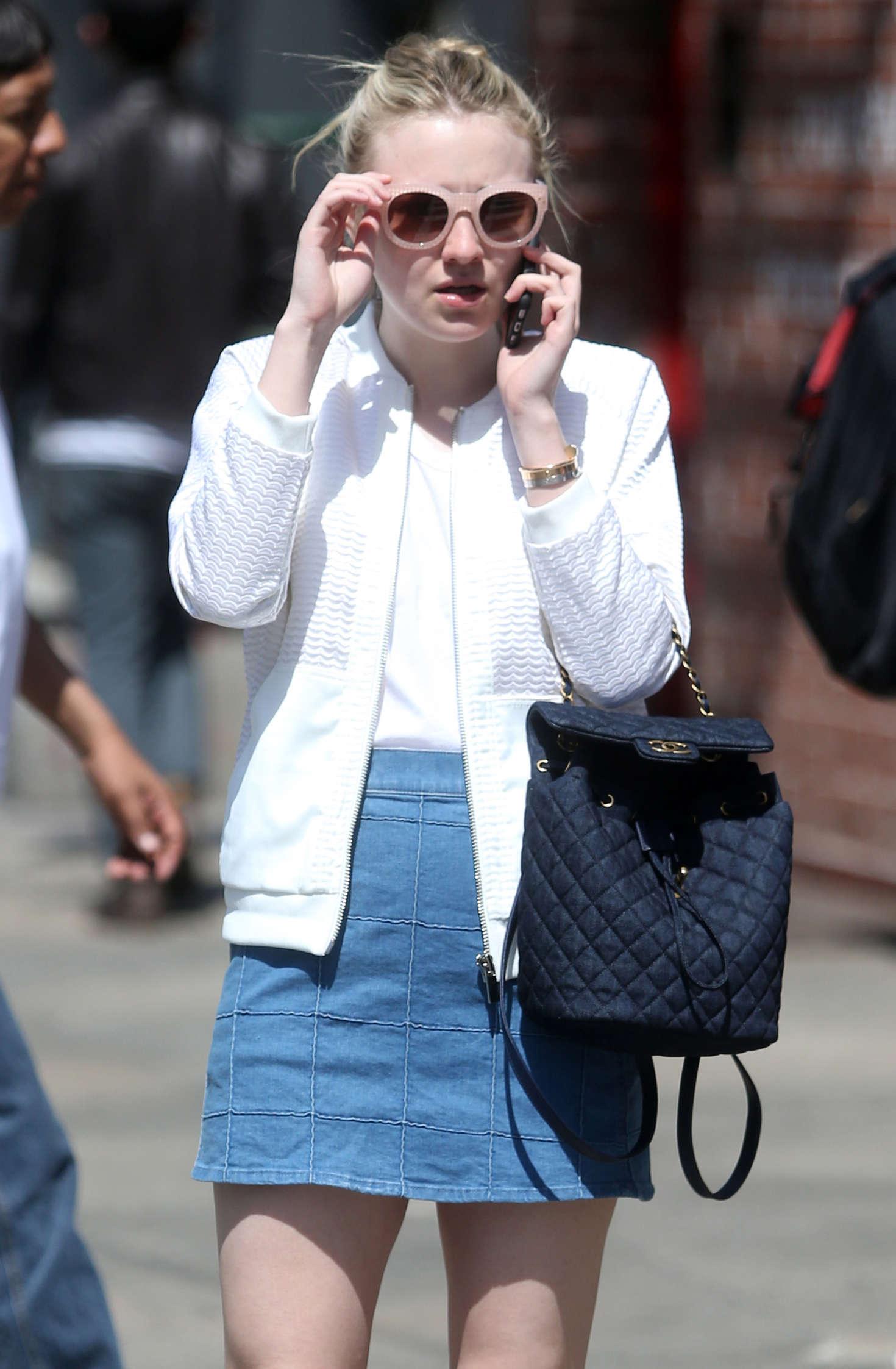Dakota Fanning in Jeans Skirt Out in New York City