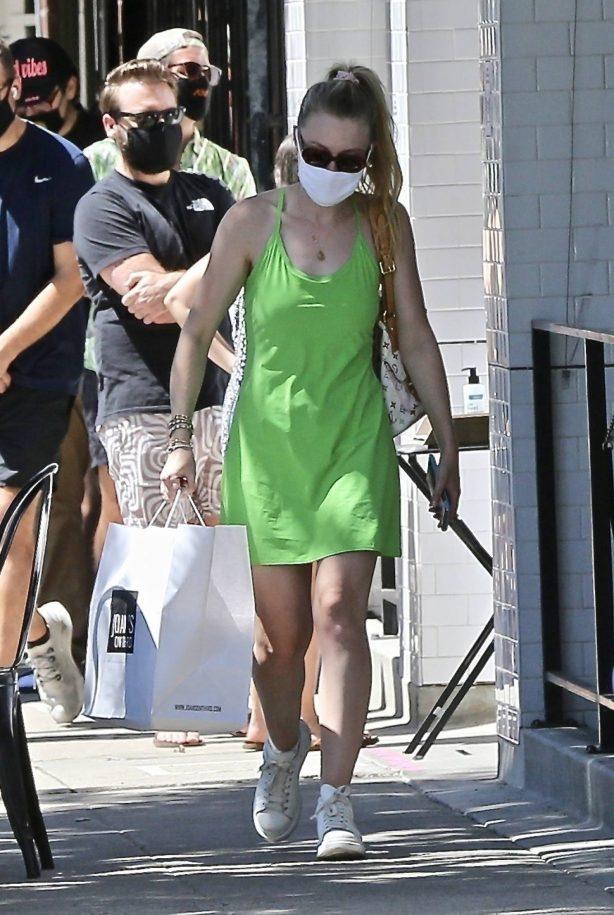 Dakota Fanning - In light green summer dress at Joan's on Third in Studio City