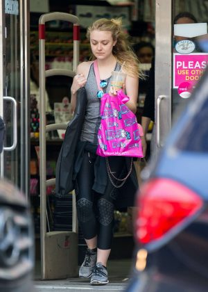 Dakota Fanning in Tights Out in New York