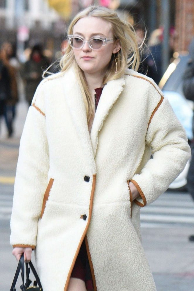 Dakota Fanning in White Coat - Out in NYC