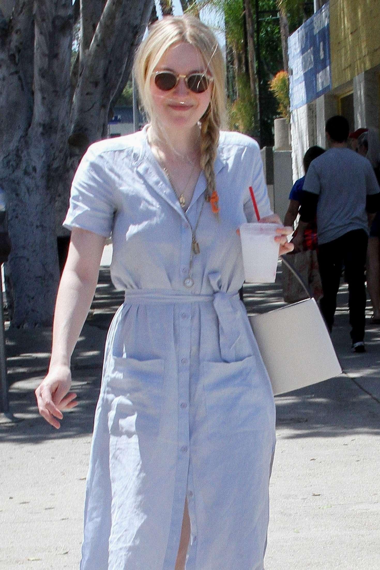 Dakota Fanning - Leaving the farmers market in Studio City