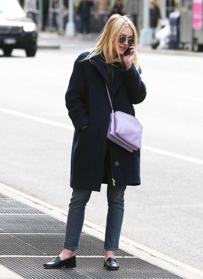 Dakota Fanning in Black Coat Out in NYC