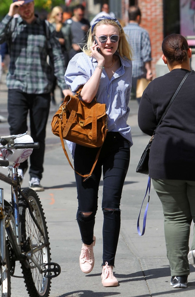 Dakota Fanning in Ripped Jeans Out in NYC