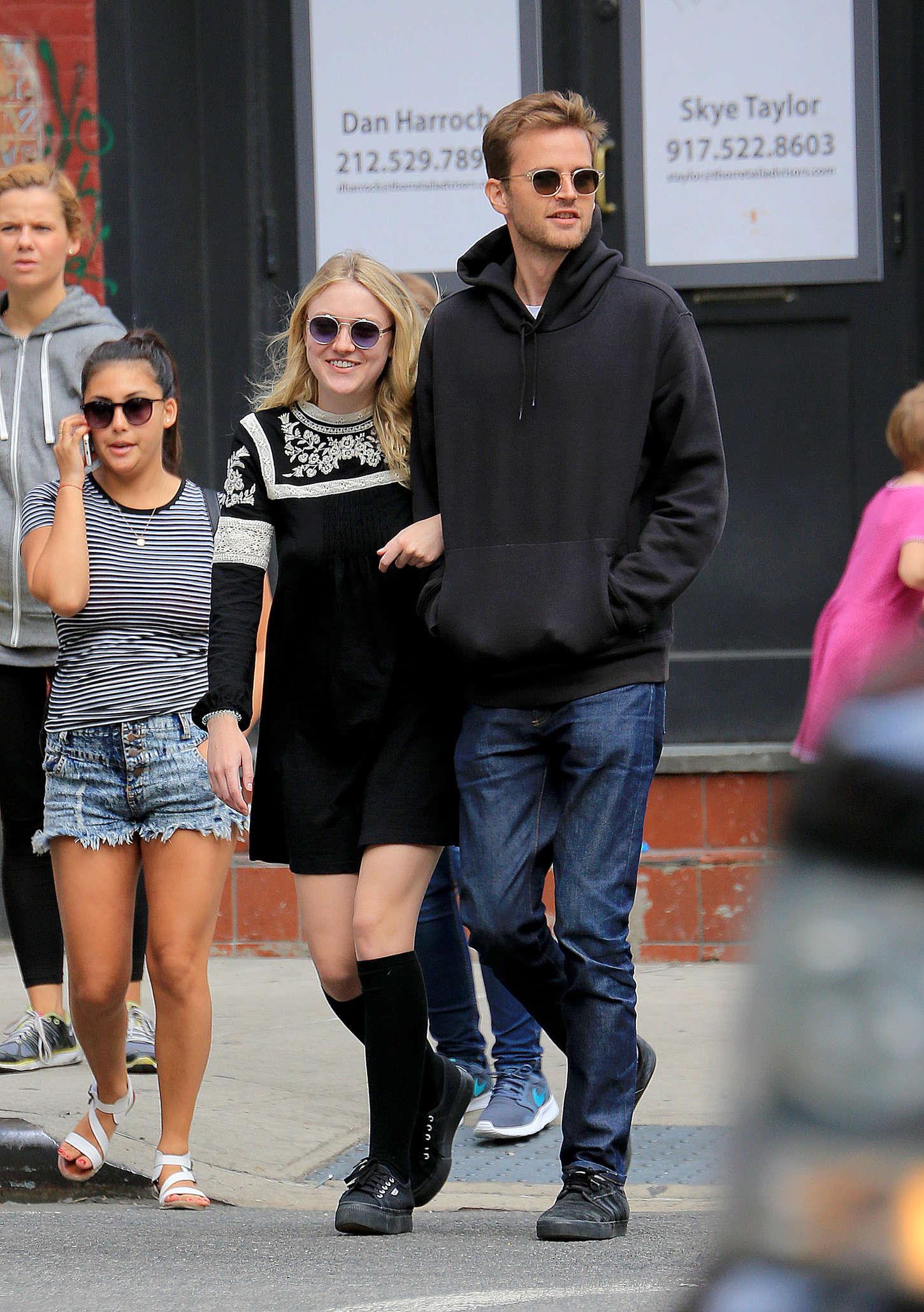 Dakota Fanning in Short Skirt Out in Soho