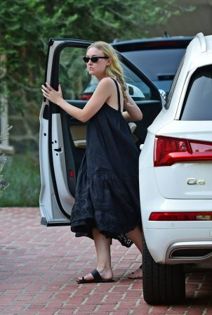 Dakota Fanning - Out from a car in Los Angeles