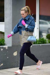 Dakota Fanning - Pink latex Gloves amid Coronavirus outbreak in LA