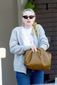 Dakota Fanning - Returning home in Los Angeles