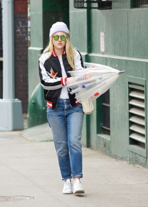 Dakota Fanning with umbrella out in New York City