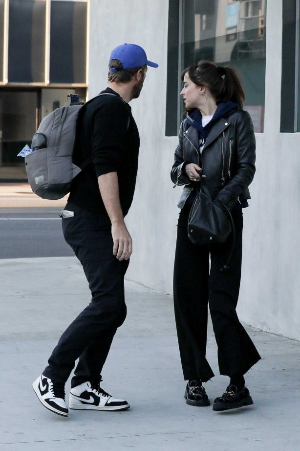 Dakota Johnson and Chris Martin at Crossroads in Los Angeles
