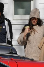 Dakota Johnson and Chris Martin - Leaving Vinnie's Barber Shop in The Hamptons