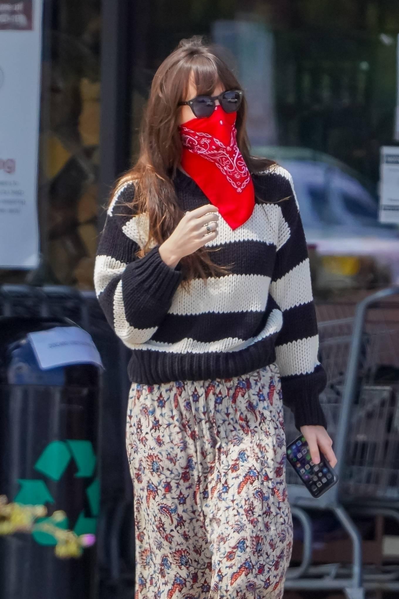Dakota Johnson and; Chris Martin - Shopping candids in Malibu
