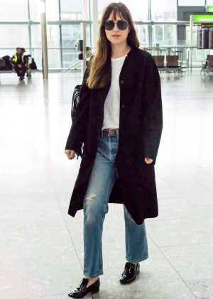 Dakota Johnson at Heathrow Airport in London