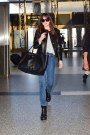 Dakota Johnson - Catch a flight out of LA in Los Angeles