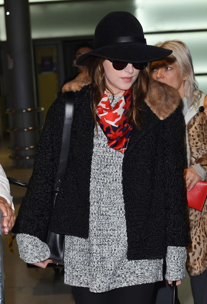 Dakota Johnson - Charles de Gaulle Airport in Paris