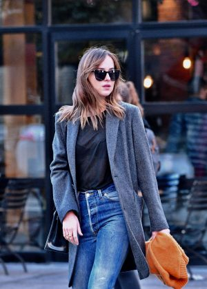 Dakota Johnson in Jeans and Coat in New York