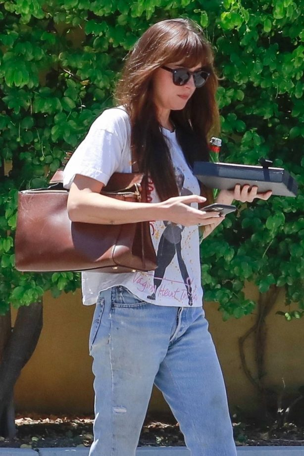 Dakota Johnson in Jeans visit to her doctor in Los Angeles