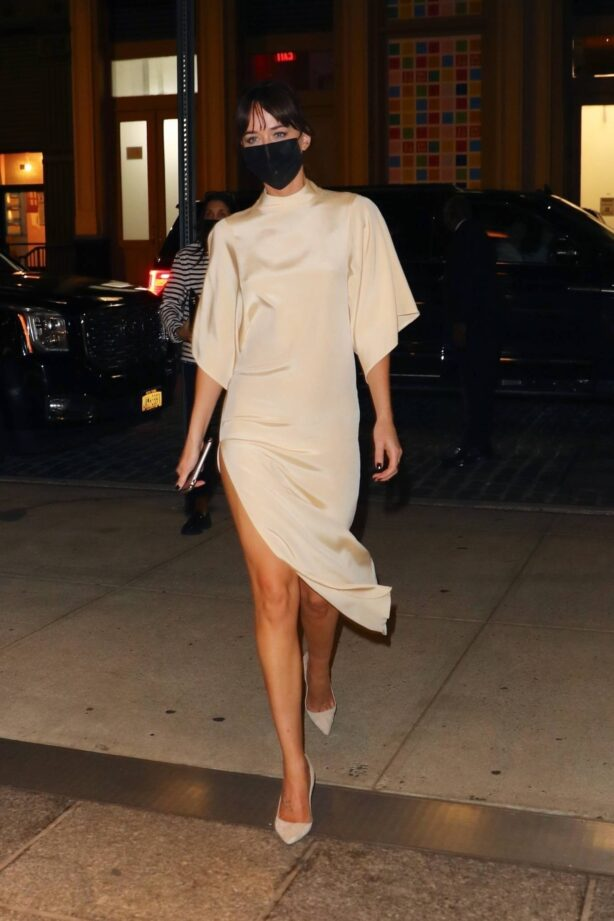 Dakota Johnson - Night out in a beige satin dress in New York