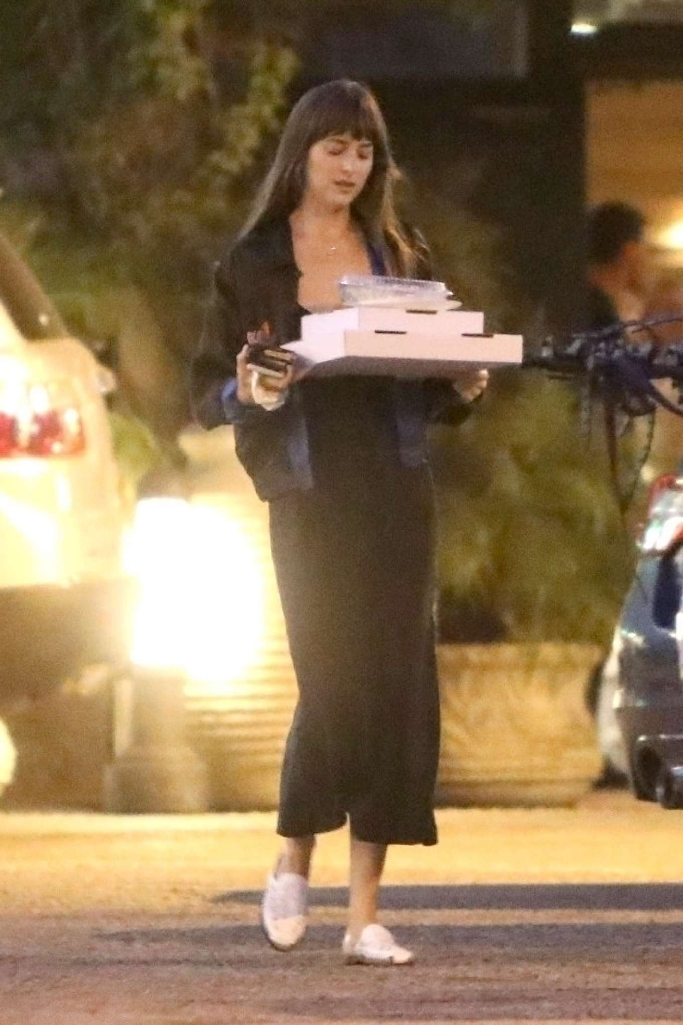 Dakota Johnson - Picks up dinner in Malibu