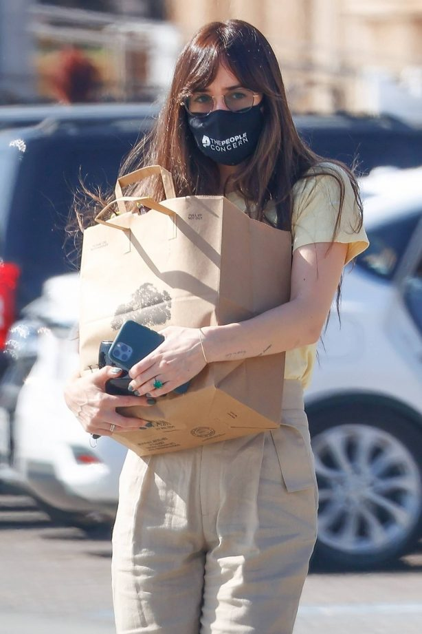 Dakota Johnson - Promotes ending homelessness with a message on her face mask in Malibu