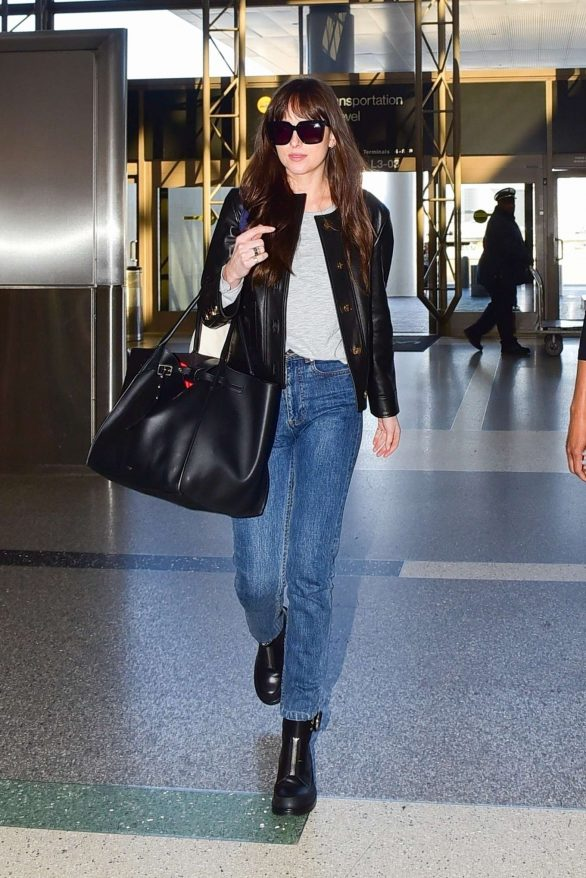 Dakota Johnson - Seen at the airport in Los Angeles
