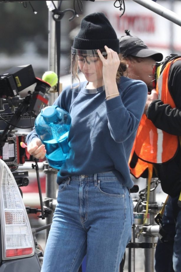 Dakota Johnson - Seen filming her latest project in a grey Prius in Los Angeles