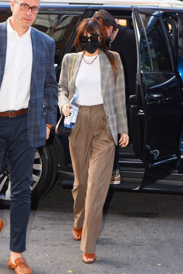 Dakota Johnson - Wears a plaid blazer as she returns to The Bowery Hotel in New York