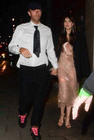 Dakota Johnson - With Chris Martin at the Claridges Hotel in London